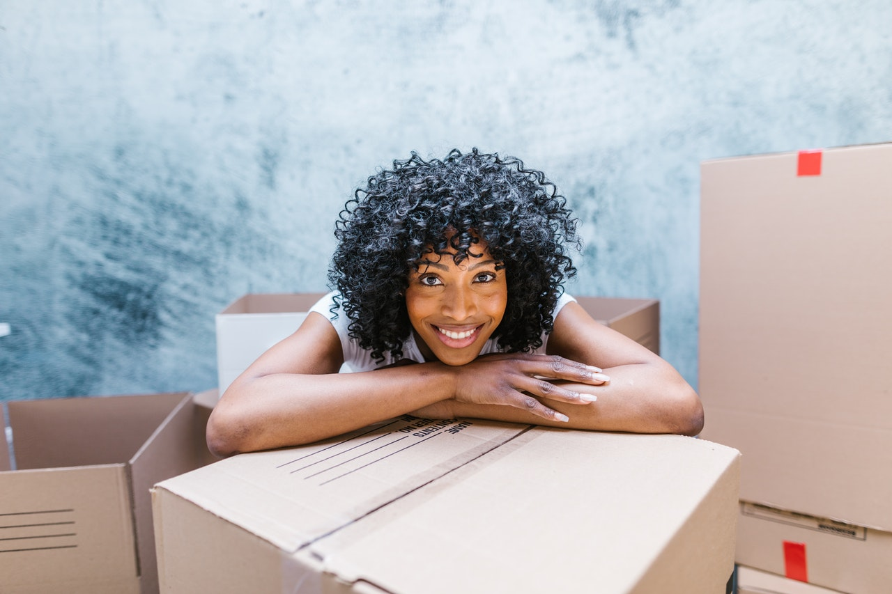 Lady leaning on box